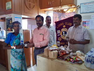Dr.K.Velavan with Lions club reaching out to poor patients .
